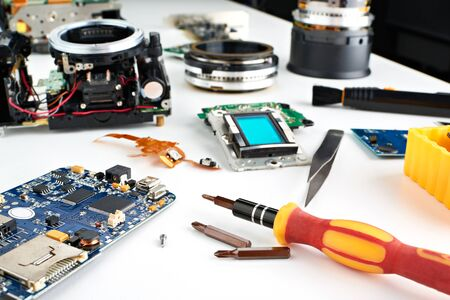 Screwdriver in the workplace service engineer to repair photo cameras