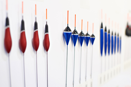 Fishing floats on white wall in a sports shop