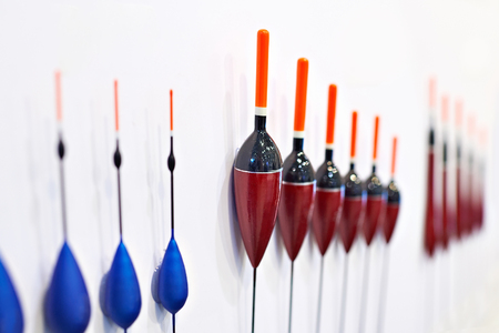 choise: Fishing floats on white wall in a sports shop