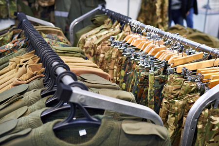 Clothing for hunting and fishing on the hanger in the store