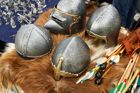 Helmets and weapons of medieval knights on furs Stock Photo