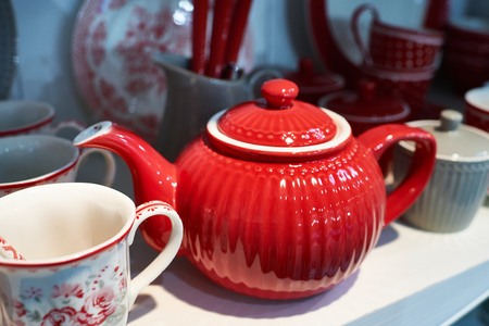 Red porcelain teapot in the sideboard