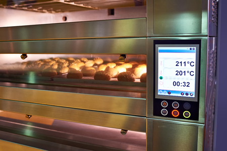LCD screen of oven with bread in the bakery