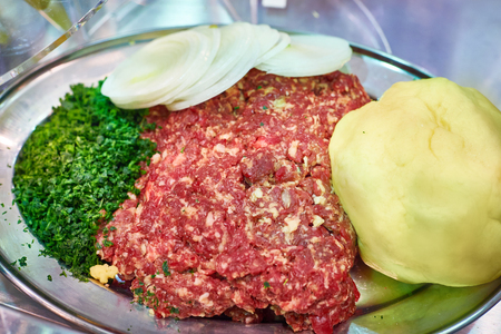 Minced meat, potatoes, onions and seasonings as additives for baking Stock Photo
