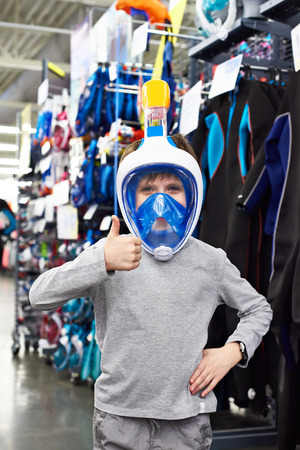 scuba goggles: Boy in the mask for scuba diving in a sports shop