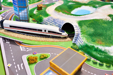 Miniature model of terrain with a railway and a modern train Stok Fotoğraf