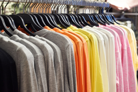 no shirt: Clothing on hangers in the store