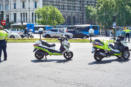 traffic warden: Traffic police with scooters in the city