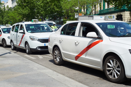 White taxi cars on Madrid street
