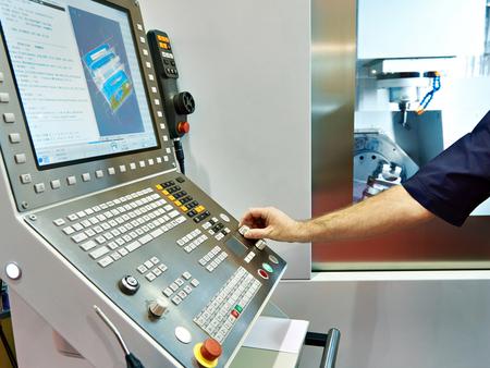 Dispatcher works on a CNC machine