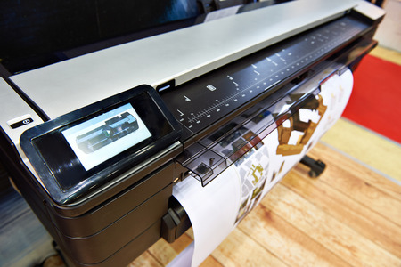 Large format printing on a color plotter 스톡 콘텐츠