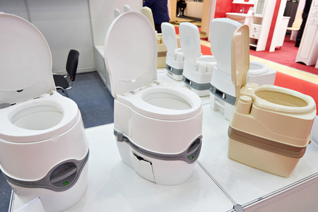 Portable toilets in the shop at the exhibition Stock Photo