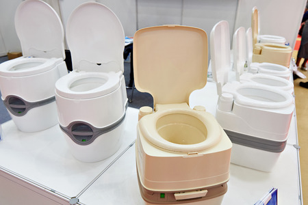 Portable chemical toilets in the shop at the exhibition Stock Photo