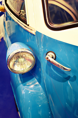 Headlight and the handle opening the door of a small single vintage car Stock Photo