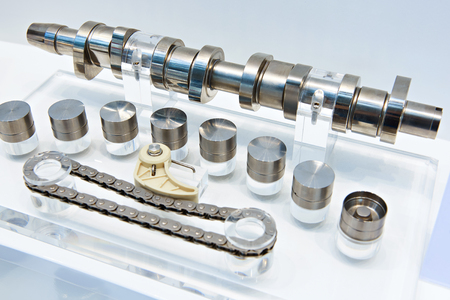 Engine components: camshaft, hidraulic valve tappet and timing chain Stock Photo
