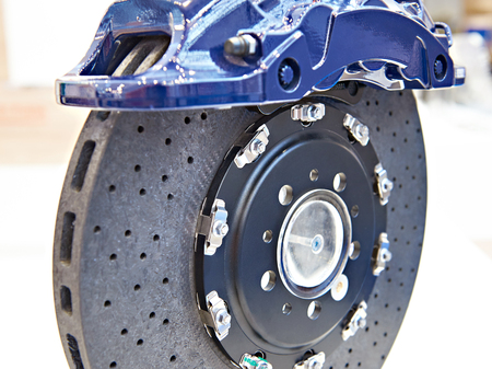 Front monoblock six piston aluminium caliper and carbon ceramic brake disc Stok Fotoğraf