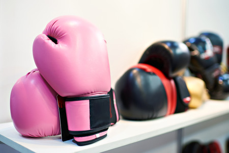 Pink boxing gloves in a sports shop