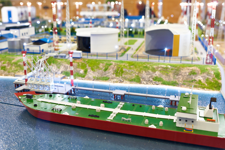 Miniature model of a tanker and layout of an oil base
