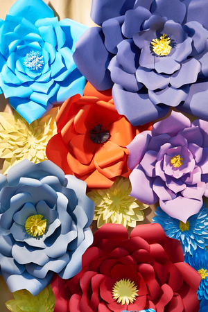 Paper colorful flowers as a beautiful background