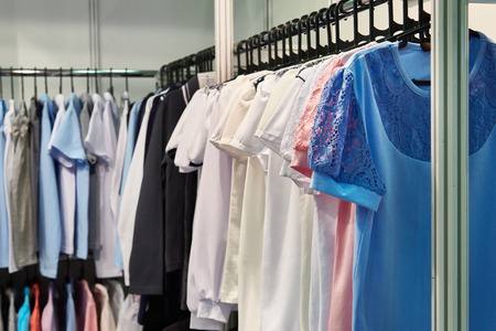 Women blouses and shirts on the hanger in the store