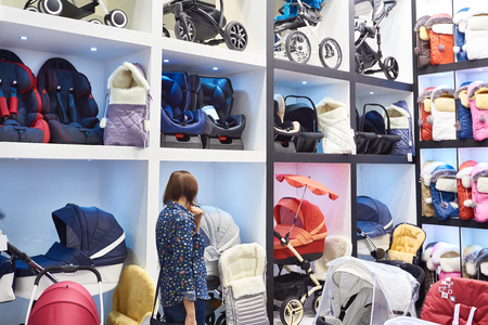 Buyer in the store of baby carriages and other childrens goods  Фото со стока