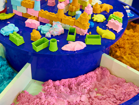Colorful kinetic sand and molds