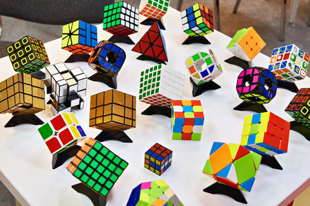Variations Rubiks Cubes on white table