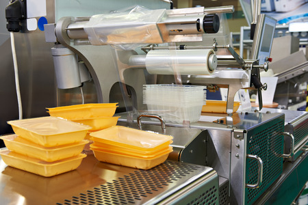 Industrial equipment for food packaging in factory Foto de archivo