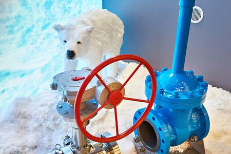 Far North. Polar bear and equipment for oil production
