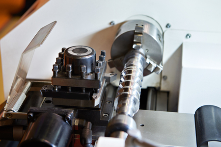 Lathe with cutters and workpiece closeup