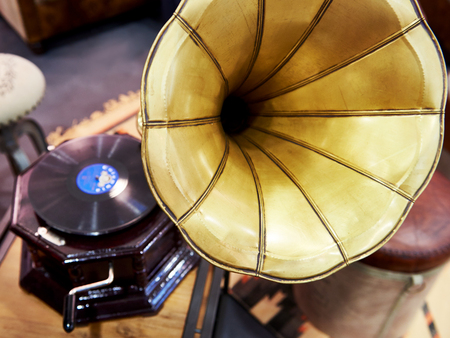Vintage antique gramophone with a phonograph record