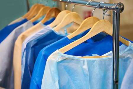 One-time medical surgical gowns on hangers