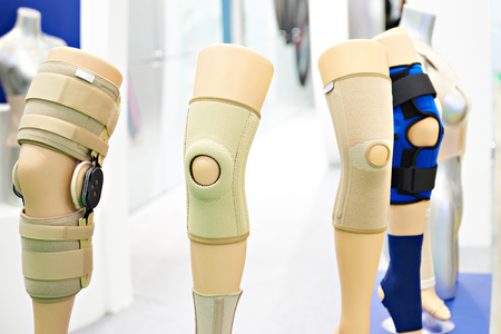 Brace on the knee joint with a sleeve made of neoprene in store