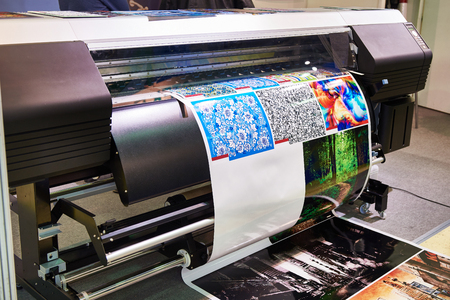 Big rolling wide plotter printer in work