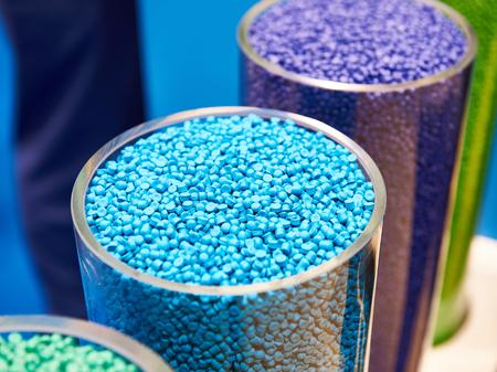 Plastic granular polymer. Samples in flasks Фото со стока