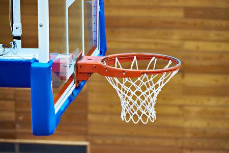 Basketball basket in the gym Фото со стока