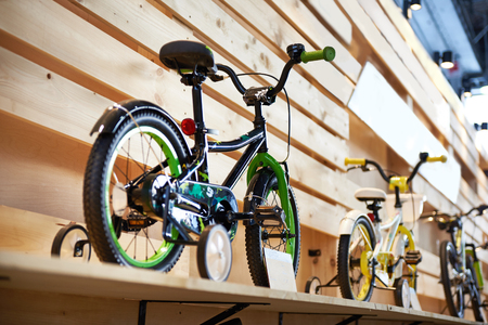 Childrens bicycles in a sports shop Фото со стока