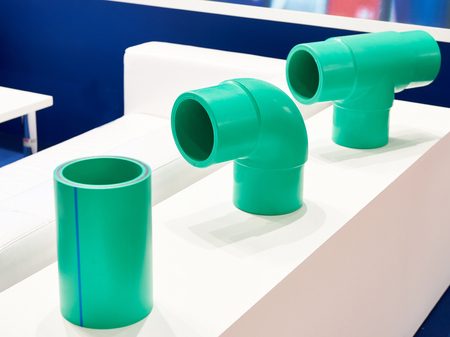 Green plastic fittings for the plumbing system Фото со стока