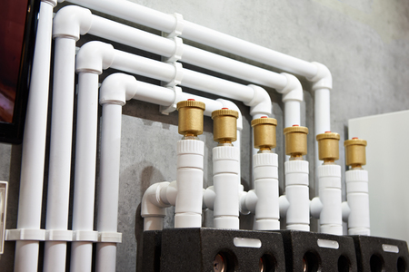 Plastic pipes of water heating system in house Фото со стока