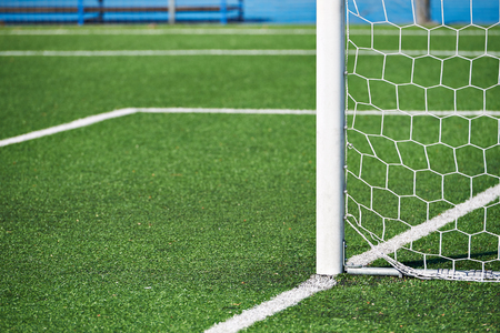 Goal post on a football field with an artificial lawn