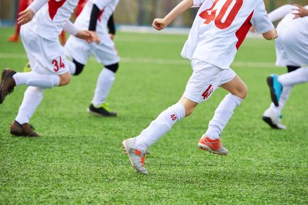 Children football players training on the football field