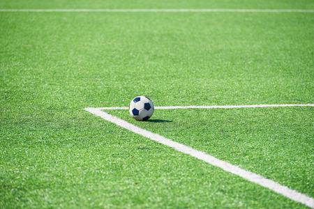 Soccer ball on the grass of the football stadium