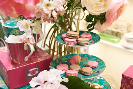 Beautiful still life with macaron biscuits and flowers