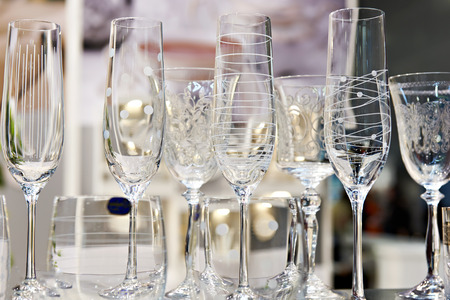 Wine glasses for wine and champagne on table Фото со стока