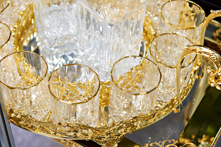 Glass cups for drinks decorated with gold