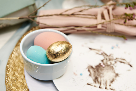 Colored and golden Easter eggs and rabbit