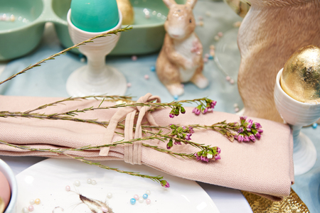Lavender flowers on a napkin and Easter eggs