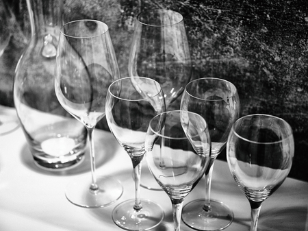 Black and white wine glasses for wine and drinks Фото со стока