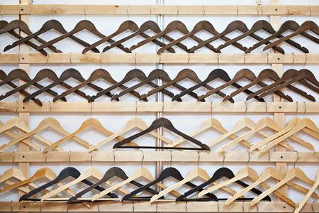 Empty wooden hangers in the store