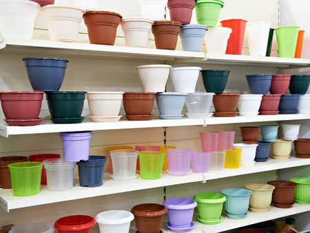 Colored plastic flower pots on the counter in the store